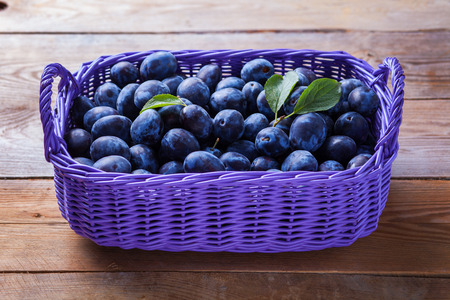 basket full of delicious plums - fruits and vegetables