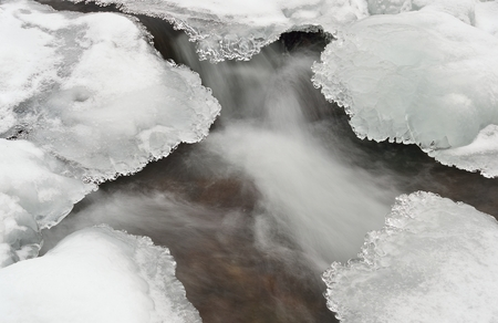gush: Water and ice in winter mountain stream