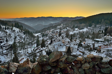 Sunset at winter in Slovakia. Old mining village. Historic church in Spania Dolina.