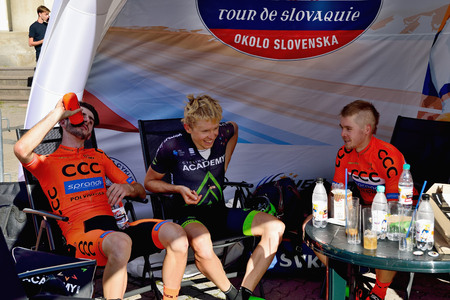 BANSKA BYSTRICA, SLOVAKIA - JUNE 08, 2017: Piotr Brozyna, Daniel Turek and Jan Tratnik conversation after second stage of road cycling championship - Tour of Slovakia Stok Fotoğraf - 80296470