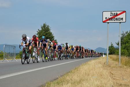 ZIAR NAD HRONOM, SLOVAKIA - JUNE 26, 2017: The Slovak and Czech National road cycling championship. Peter Sagan, Bora Hansgrohe in peloton. World champion in rainbow jersey. Stok Fotoğraf - 81332385