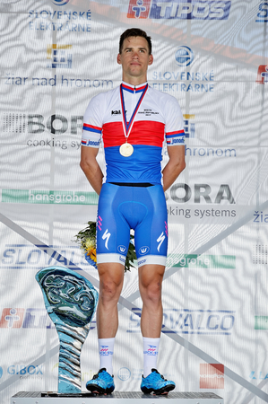 ZIAR NAD HRONOM, SLOVAKIA - JUNE 26, 2017: The Slovak and Czech National road cycling championship. Medail ceremony. Zdenek Stybar from Quick Step Floors cycling team with gold medail Stok Fotoğraf - 81396991