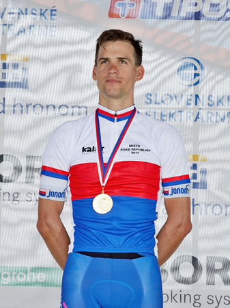 ZIAR NAD HRONOM, SLOVAKIA - JUNE 26, 2017: The Slovak and Czech National road cycling championship. Medail ceremony. Zdenek Stybar from Quick Step Floors cycling team with gold medail Stok Fotoğraf - 81396994