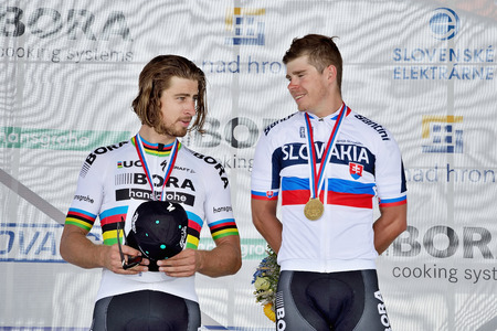 ZIAR NAD HRONOM, SLOVAKIA - JUNE 26, 2017: The Slovak and Czech National road cycling championship. Medail ceremony. Sagan brothers from Bora Hansgrohe cycling team with gold and silver medail. Free public meeting Stok Fotoğraf - 82045630