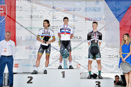 ZIAR NAD HRONOM, SLOVAKIA - JUNE 26, 2017: The Slovak and Czech National road cycling championship. Elite category medail ceremony. Sagan brothers and Erik Baska from Bora Hansgrohe cycling team. Free public meeting Stok Fotoğraf - 82045632
