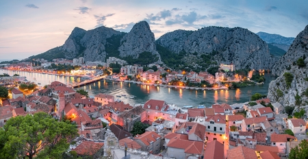 City of Omis, Dalmatia, Croatia. Blue hour landscape view in historical city centre of Omis and Cetina river. Popular holiday destination in Croatia