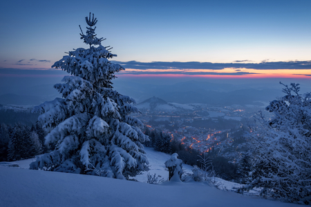 Winter landscape in Slovakia. Stiavnicke mountains under snow. Frozen snowy trees and dark sky panorama. Stok Fotoğraf
