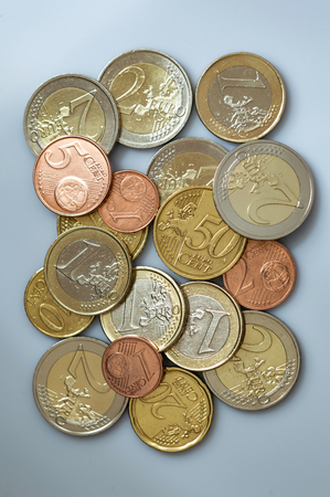 Various euro coins. Stacked euro coins of different values on gray background. Stok Fotoğraf