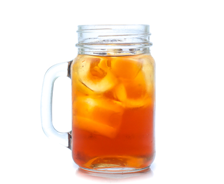 jar glass of iced tea with lemons  isolated on a white background