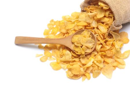 Cornflakes in zak die op witte achtergrond wordt geïsoleerd