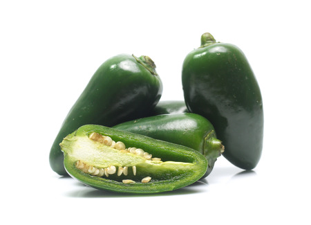 green chilies on white background (jalapeno)