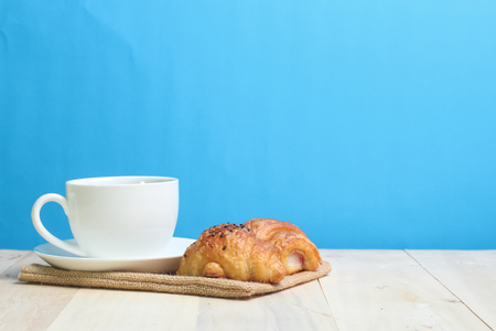 Croissant and coffee   on wood table