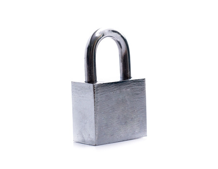 Metal padlock with keys on a ring isolated on white background Stock Photo