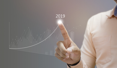 business man hand working with new modern computer and business strategy as graph concept 스톡 콘텐츠