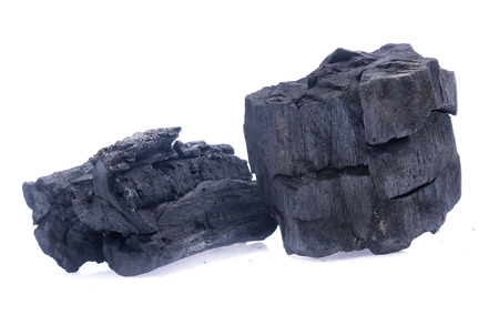 Natural wood charcoal Isolated on white 版權商用圖片