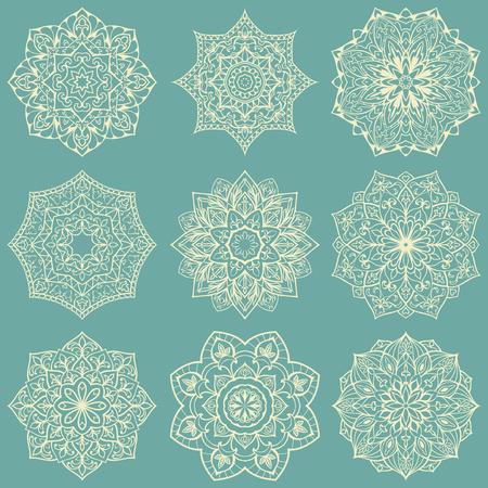 bordados: Plantilla para el bordado. Conjunto de mandalas. Colección de estrellas estilizadas y copos de nieve sobre un fondo azul claro. Redondo del vector adornos étnicos. Bocetos para el tatuaje. Detalles decorativos arquitectónicos.