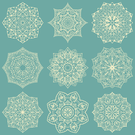 Template for embroidery. Set of mandalas. Collection of stylized stars and snowflakes on a light blue background. Vector round ethnic ornaments. Sketches for tattoo. Architectural decorative details. Illustration