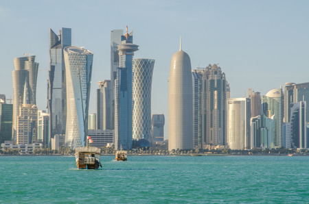 The skyline of Doha, Qatar, with a dhow in the foreground. Stock Photo