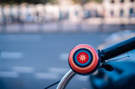 a close-up of a bicycle bell in city environment
