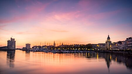 Old harbour of La Rochelle, the French city and seaport. beautiful colorful sky and clouds. long exposure photography