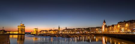 Old harbor of La Rochelle, the French city and seaport at sunset. Panoramic view