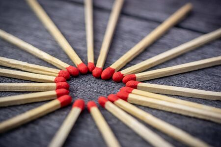 Matchstick with a red heart-shaped head on a wooden background. 스톡 콘텐츠 - 149013221