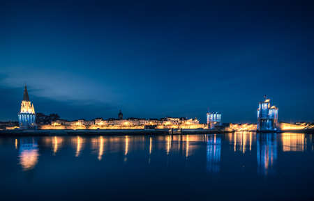 Panoramic view of the old harbor of La Rochelle at blue hour with its famous old towers