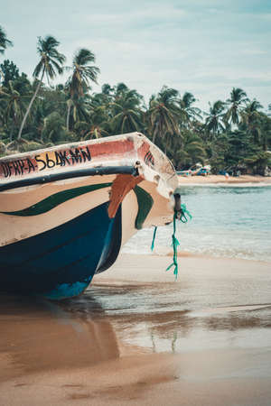 detail of a white and blue fishing boat on the beach. old rope on the prow, Arugam bay, Sri lanka Stock Photo