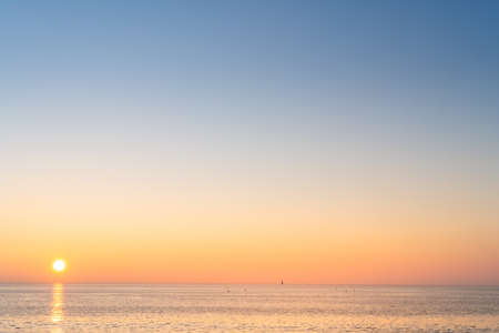 Panorama of Re island beaches with a little lighthouse in the horizon at sunrise with a very calm sea. beautiful minimalist seascape.