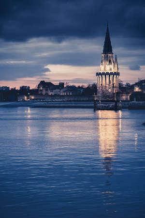 Night view of the Tour de la lanterne in La Rochelle, France. beautiful reflection in the harbor water