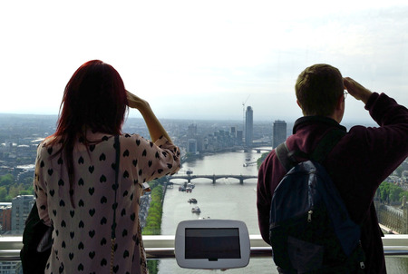 Two people looking the landscape of London from the London Eye. photo