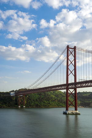 twin sister: The April 25 Bridge connects the banks of the Tagus River in Lisbon. Often Considered as a twin sister of the Golden Gate Bridge in San Francisco Stock Photo