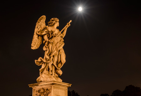 ices: Statue of Angel with spear at SantAngelo Castle and Moon in the background Editorial