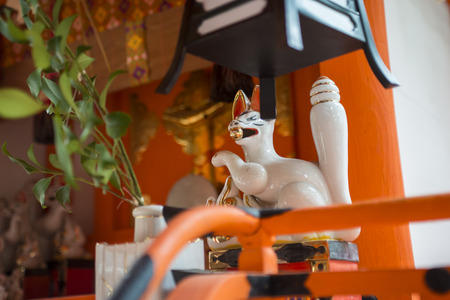 spiritual architecture: Kyoto, Japan - October 22, 2015: A little statue of a cat at Yasaka Shrine in the Gion District. Editorial