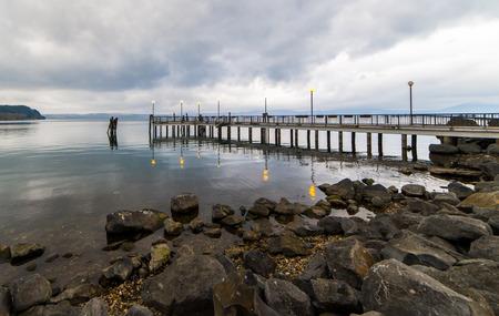 View of Anguillara and Bracciano lake pier Stock Photo