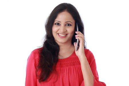 ul young woman talking on mobile phone against white