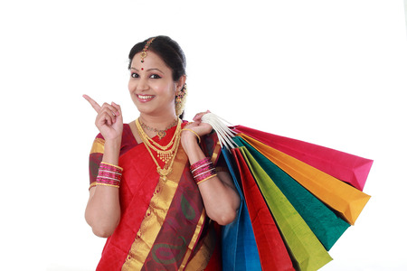 Young traditional woman holding shopping bags