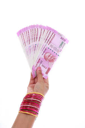 indian subcontinent ethnicity: Hand holding Indian 2000 rupee notes - Stock Photo