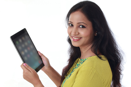 Smiling beautiful young woman with tablet computer Stock Photo