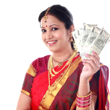 Traditional woman holding new 500 rupee notes Stock Photo