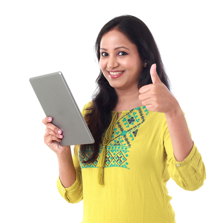 Young happy Woman using a tablet computer against white background Stock Photo