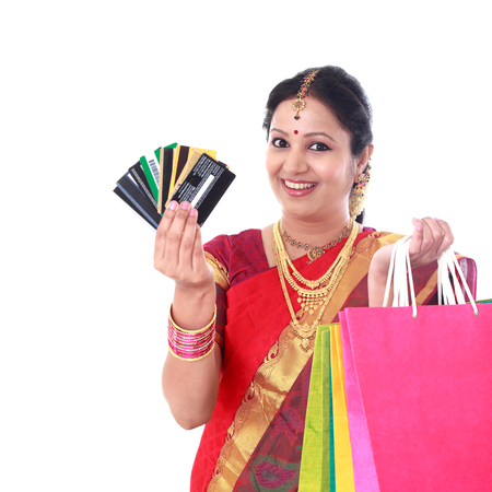 Smiling woman with shopping bags and holding a credit card Stock Photo