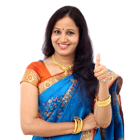 Traditional young Indian woman showing thumb up Stock Photo