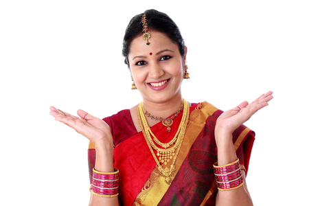 Excited traditonal Indian woman against white background Stock Photo