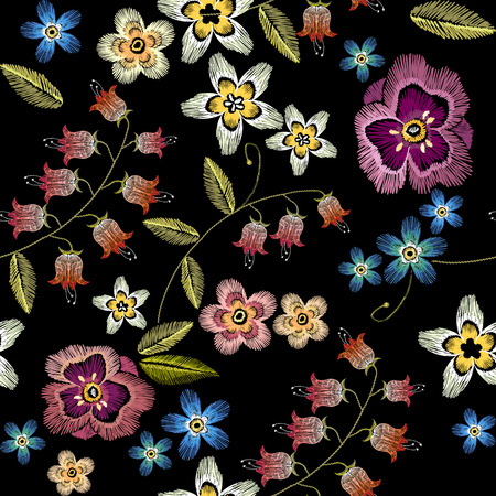 Embroidery flowers seamless pattern. Fashionable template for design of clothes. Beautiful camomiles, cornflowers, classical embroidery seamless background