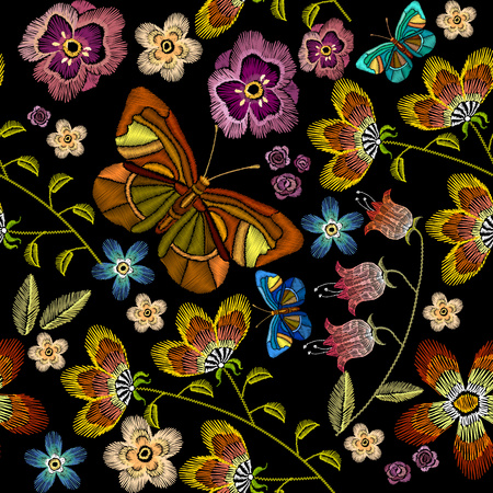 Embroidery flowers and butterflies seamless pattern. Beautiful camomiles, cornflowers, classical embroidery on black background,  fashionable template for design of clothes