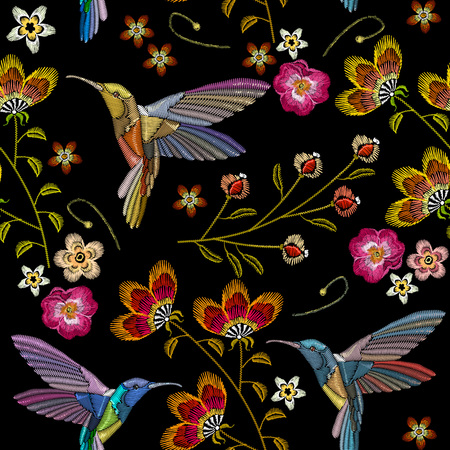 Humming bird and tropical flowers embroidery seamless pattern. Beautiful hummingbirds and exotic flowers embroidery on black background. Template for clothes, textiles, t-shirt design Stock Illustratie