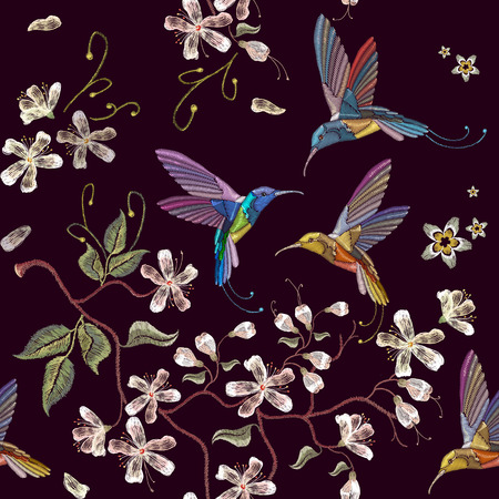 Humming bird and blossoming cherry embroidery seamless pattern. Beautiful hummingbirds and white blossoming cherry sakura flowers on black background template for clothes, textiles, t-shirt design