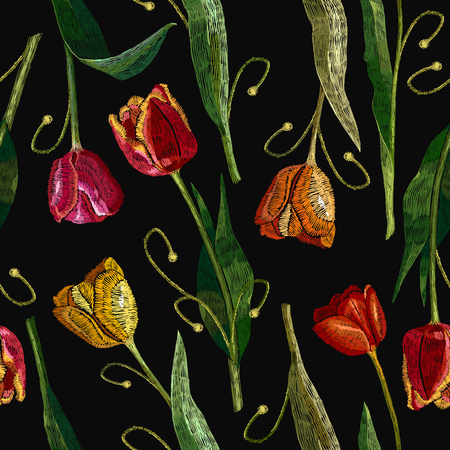Embroidery tulips seamless pattern. Classical embroidery red and yellow tulips. Fashionable template for design of clothes, t-shirt design, tapestry
