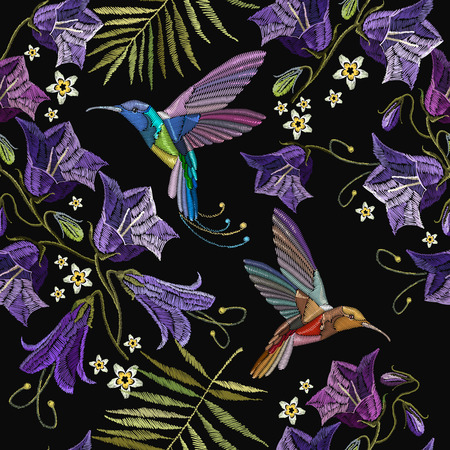 Embroidery violet flowers bells and humming bird seamless pattern. Beautiful violet cornflowers and humming bird, classical embroidery pattern. Fashionable template for design of clothes